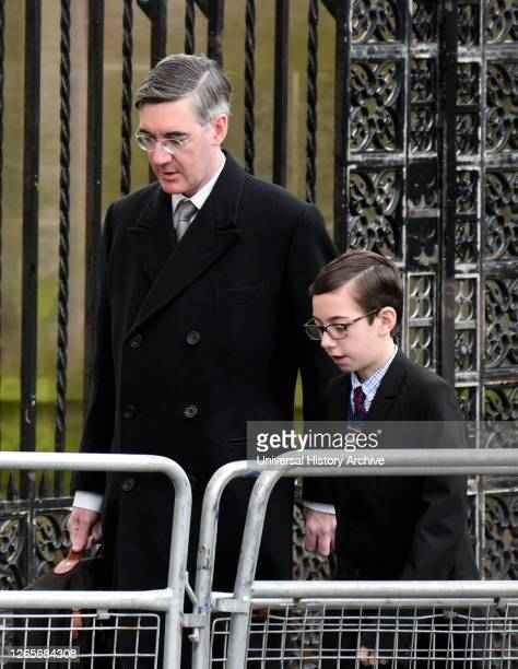 Photograph of Jacob Rees-Mogg with his son, arriving for the state opening of Parliament. Jacob William Rees-Mogg a British politician serving as...
