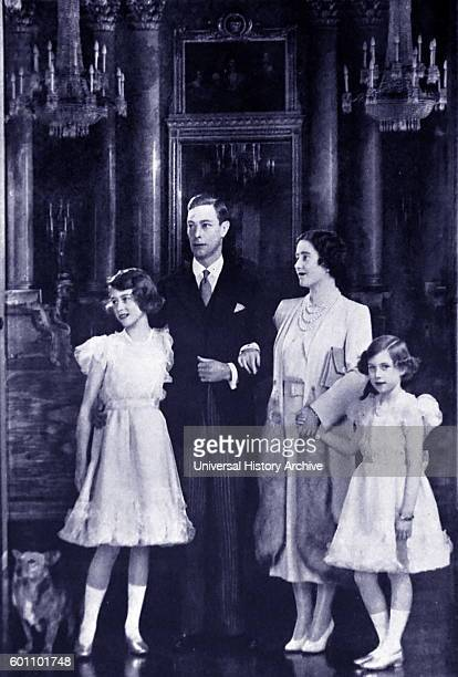 Photograph of King George VI the Queen Mother Queen Elizabeth II and Princess Margaret at Windsor Castle Dated 20th Century