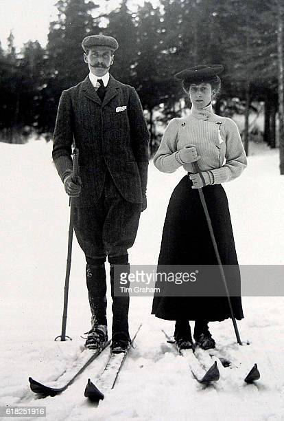 A photograph of King Haakon and Queen Maud skiing on display at the 'Style and Splendour Queen Maud of Norway's Wardrobe 18961938' exhibition at the...