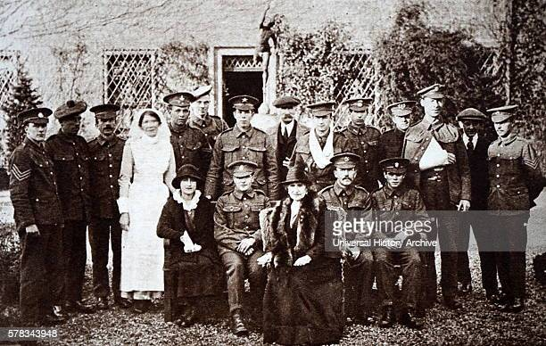 Photograph of Lady Elizabeth BowesLyon at Glamis Castle with a wounded soldiers from the Great War Dated 20th Century