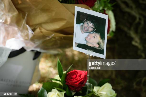 A photograph of Lee Harris and Samantha Badham two of the those killed in the attack is seen on a floral tribute at the 7/7 memorial in Hyde Park on...
