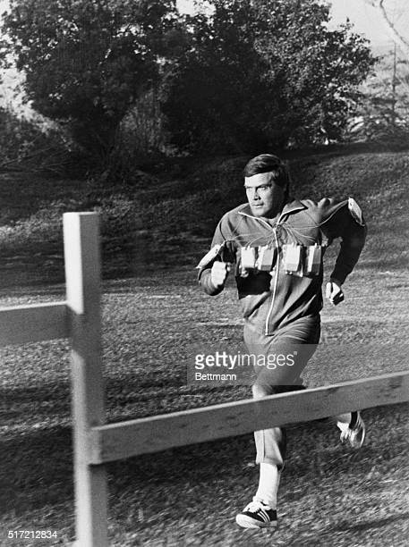 """Photograph of Lee Majors in a scene from his television show """"The Six Million Dollar Man."""" Filed in 1976."""