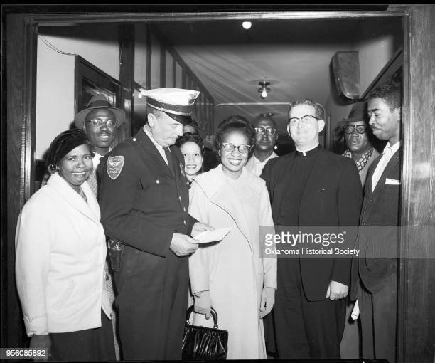 Photograph of left to right Mrs Ella Floyd Ed Stamps a police officer Mrs Freddie Moon Clara Luper Dr E C Moon Father Robert McDole A Willie James...