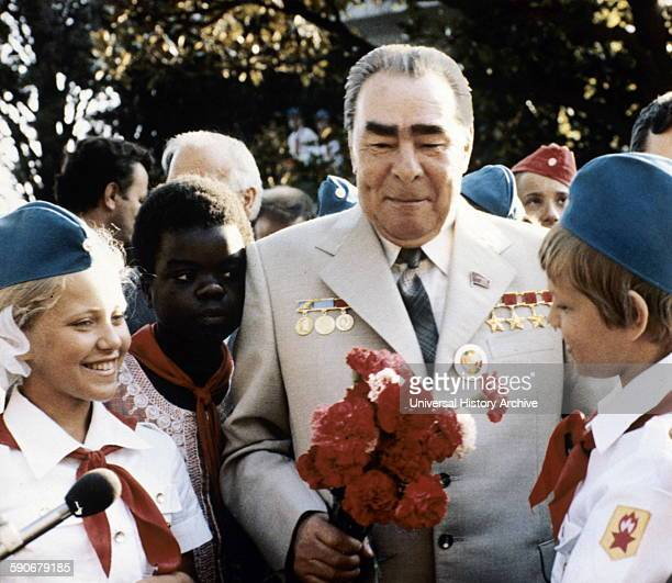 Photograph of Leonid Brezhnev with International communist youth in USSR 1980