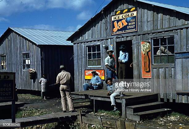 Photograph of living quarters and juke Joint for migratory workers Belle Glade Florida Photographed by Marion Post Wolcott a noted American...