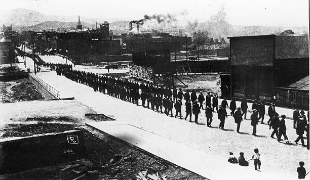 A Photograph of Men Lining up During the Ludlow Massacre,...