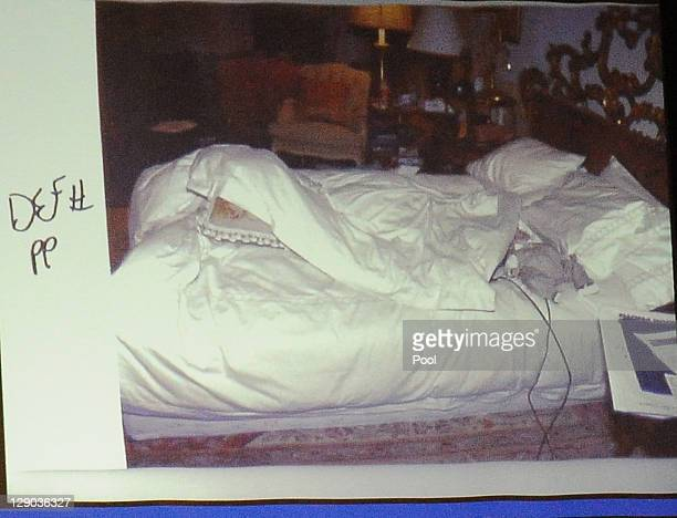 A photograph of Michael Jackson's bedroom is projected as Defense attorney Ed Chernoff cross examens LAPD Det Scott Smith during Dr Conrad Murray's...