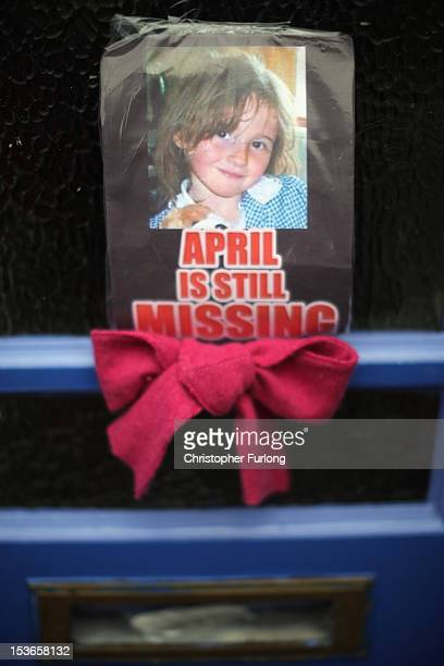 A photograph of missing fiveyearold April Jones adorns a door as police continue their search to find the 5 year old girl on October 8 2012 in...