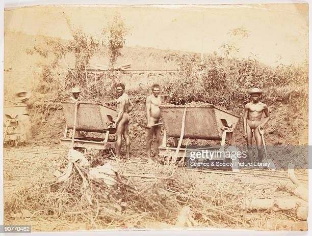 A photograph of native workers employed in the construction of the Panama Canal from an album entitled 'Canal Interoceanique de Panama' They have...