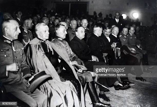 Photograph of Nazi leaders gathered with French leaders for an evening event in Paris Emmanuel Celestin Suhard Cardinal Archbishop of Paris with...