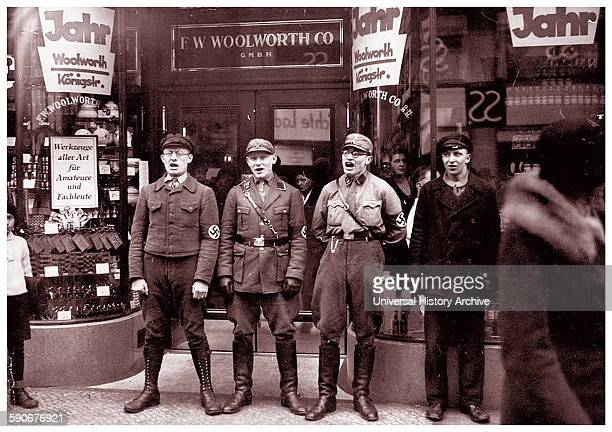 Photograph of Nazis singing to encourage a boycott of the allegedly Jewishfounded Woolworths Dated 1933