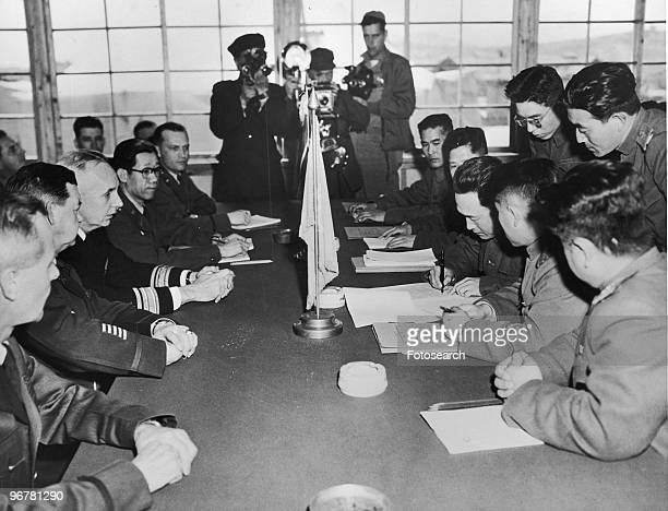 A Photograph of North Korean Major General Lee Sang Jo Signing the Official Documents on Agreement of Exchanging Sick and Wounded Prisoners of War at...