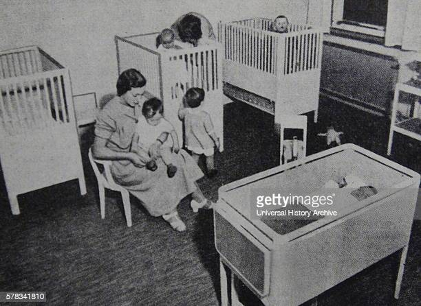 Photograph of nurses caring for children and infants at a child care centre Dated 20th Century