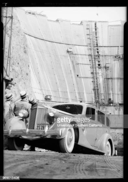 Photograph of Packard and men at Boulder Dam [Hoover Dam] site, Nevada, 1934.