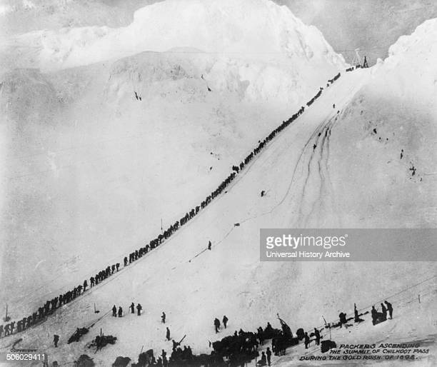 Photograph of packers ascending the summit of Chilkoot Pass during the Gold Rush of 1898 Photo by