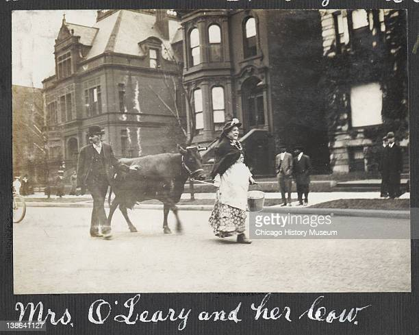 Photograph of people dressed as 'Kate and Patrick O'Leary' and their cow as part of the 40th anniversary celebration of the Great Chicago Fire of...