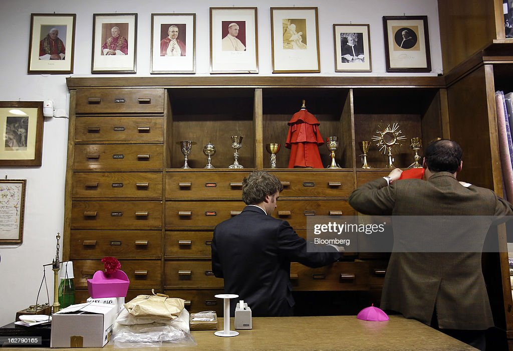 A photograph of Pope Benedict XV sits alongside images of his predecessors inside Gammarelli, an ecclesiastical tailors store in Rome, Italy, on Friday, Feb. 22, 2013. Gammarelli was founded in 1797 under Pope Pius VI as tailors to the clergy, and lists other papal customers as John Paul I, Paul VI, and John XXIII. Photographer: Alessia Pierdomenico/Bloomberg via Getty Images