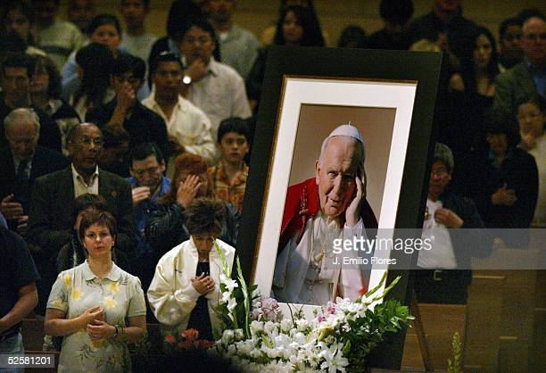 A photograph of Pope John Paul II is displayed during a Mass at Our Lady of Angels cathedral April 2 2005 in Los Angeles California