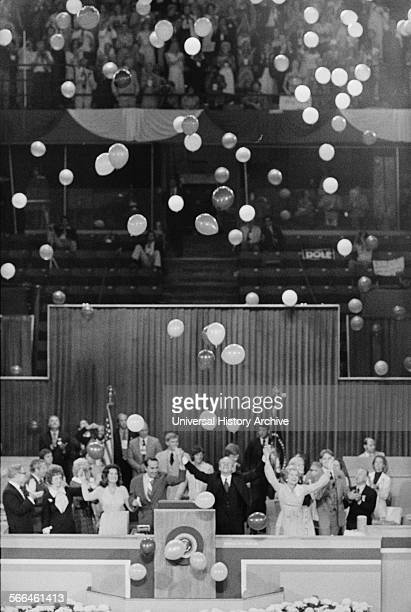 Photograph of President Gerald Ford First Lady Betty Ford Senator Bob Dole and Elizabeth Dole celebrate winning the nomination amidst floating...