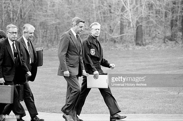 Photograph of President Jimmy Carter Vice President Walter Mondale Secretary of State Cyrus Vance and Secretary of Defence Harold Brown on their way...
