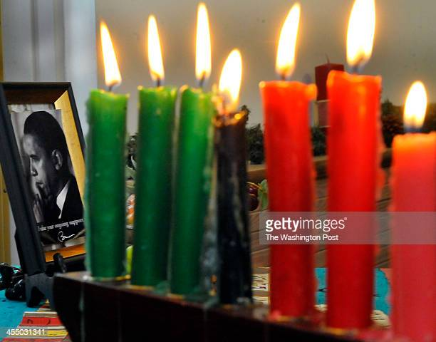 A photograph of President Obama sta beside the lit candles during the Kwanzaa celebration at the Benjamin Banneker Historical Park and Museum on...