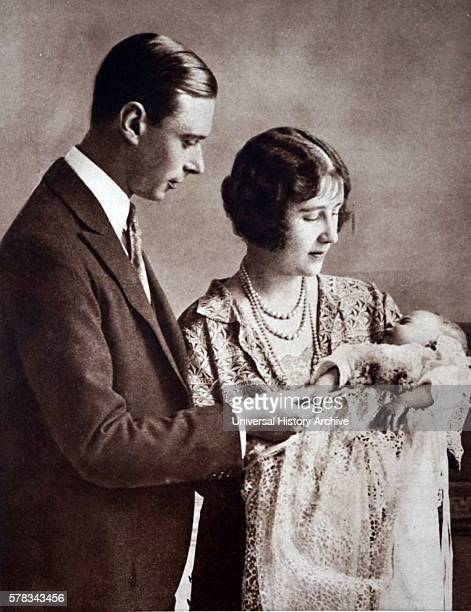Photograph of Prince Albert Frederick Arthur George and Lady Elizabeth Bowes-Lyon with the new born Princess Elizabeth . Dated 20th Century.