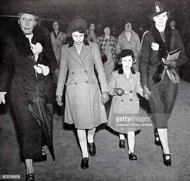 Photograph of Princess Elizabeth and Princess Margaret with Lady Helen Graham and Miss Marion Crawford after their first ride on the Underground Rail...