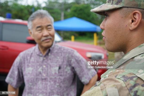 Photograph of Private First Class Hoaka Corteskanaina with Hawaiian governor David Ige during a tour of ground conditions following a volcanic...