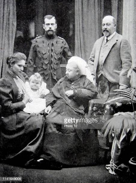 Photograph of Queen Victoria sat in the foreground alongside Tsarina Alexandra Fyodorovna and the infant Grand Duchess Olga Nikolaevna of Russia In...