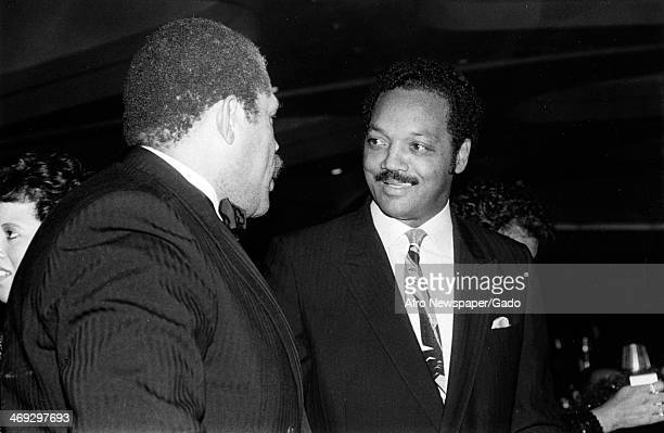 Photograph of Rev Jesse Jackson Baptist minister and civil rights leader and Reggie Jackson professional baseball player 1980