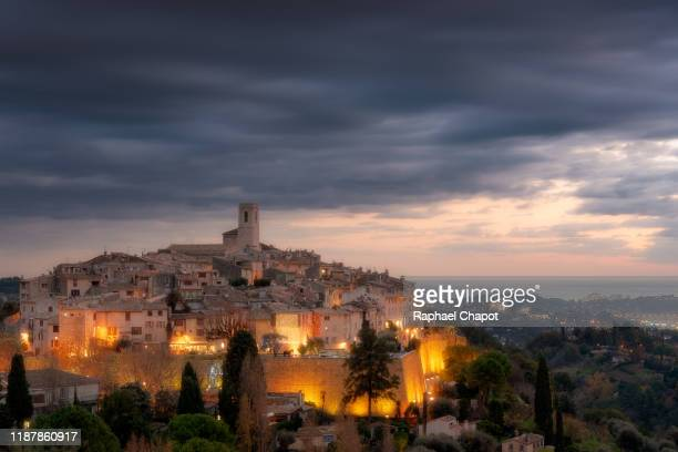 photograph of saint-paul-de-vence during sunset.  french riviera, france - サンポールドヴァンス ストックフォトと画像