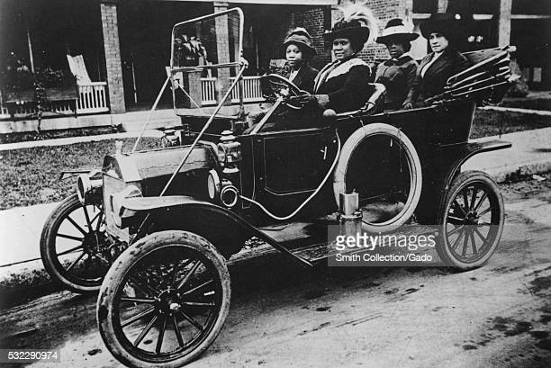 Photograph of Sarah Breedlove driving a car, she was better known as Madam C.J. Walker, the first woman to become a self-made millionaire in the...