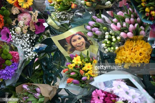 Photograph of Sarah Everard is left with tributes to her at the bandstand on Clapham Common on March 13, 2021 in London, United Kingdom. Vigils are...