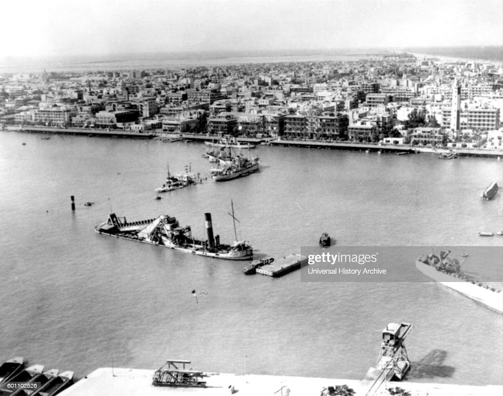 Photograph of scuttled ships blocking the entrance to the Suez canal at Port Said : News Photo