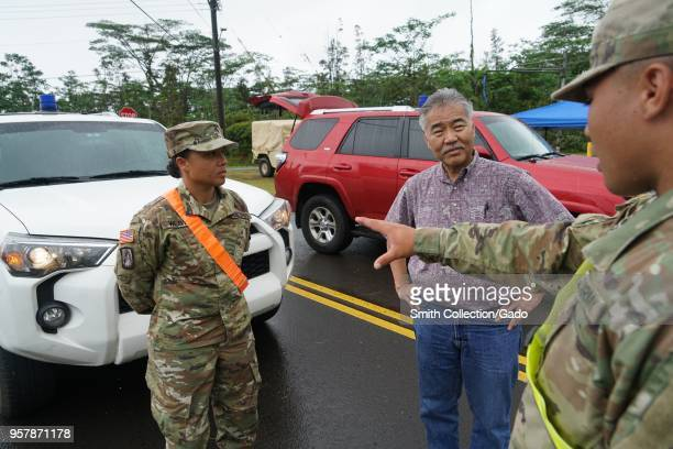 Photograph of Sergeant Chantel Weaver and Private First Class Hoaka Corteskanaina with Hawaiian governor David Ige during a tour of ground conditions...