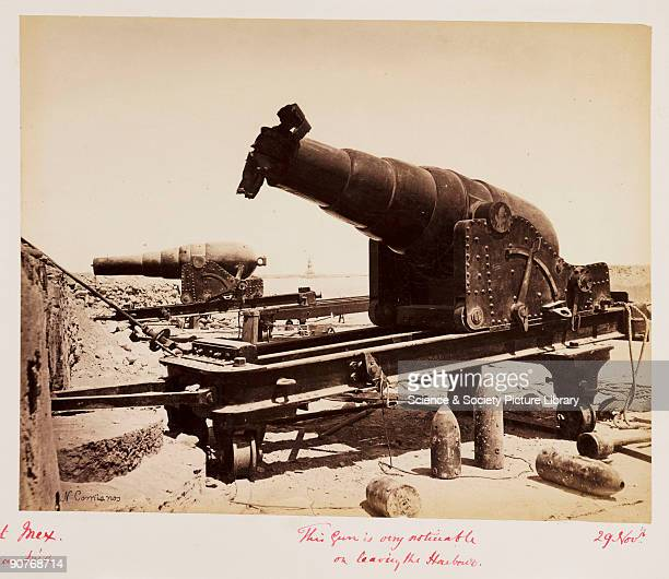 Photograph of shells and damaged guns on the walls of Fort Mex captioned �This gun is very noticeable on leaving the harbour� Fort Mex was one of...