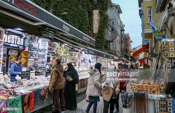 Photograph of shoppers at a colorful street market Istanbul Turkey November 15 2017