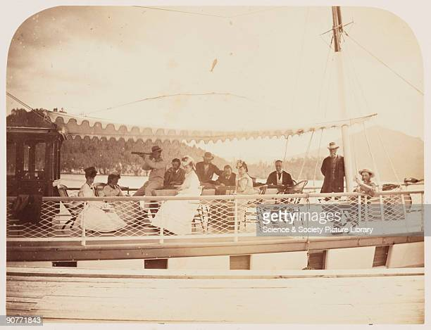 Photograph of Sir Hugh Allen , relaxing with his family on board his yacht on Lake Memphremagog in Belmere, Canada, taken by William McFarlane Notman...