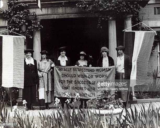 Photograph of six suffragists at the 1920 Republican National Convention in Chicago gathered in front of a building with suffrage banners Mrs James...
