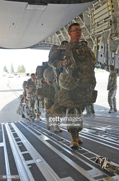 Photograph of soldiers from the 201st Expeditionary Military Intelligence Brigade boarding a C17 Globemaster III transport aircraft during a field...