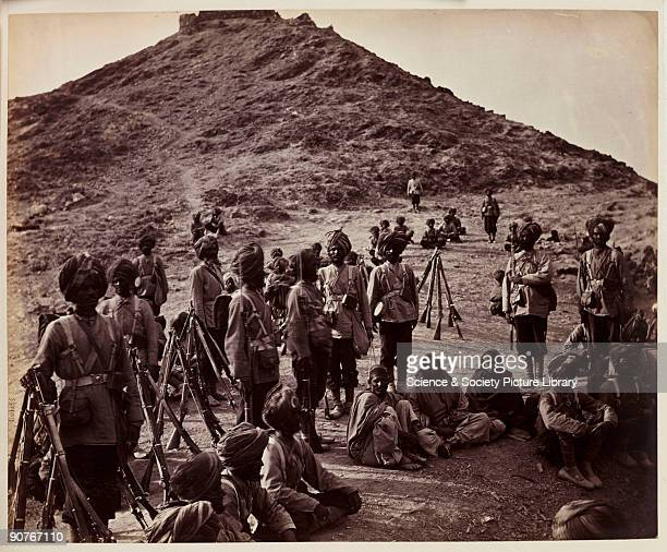 Photograph of soldiers of the 45th Rattray's Sikh Regiment guarding Afghan prisoners, taken by John Burke [1845-1900] in about 1878. This photograph...