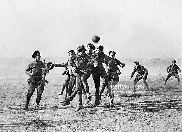 Photograph of soldiers playing football in No-Man's Land during the Christmas Truce. Dated 1914.