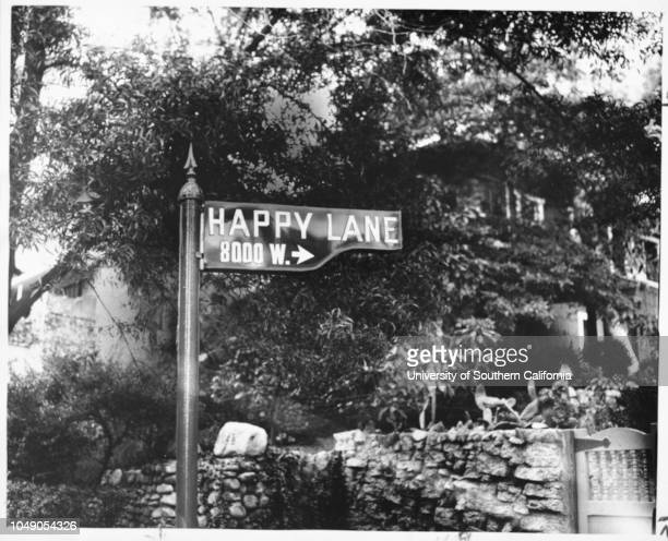 Photograph of street sign for West Happy Lane 8000 West in the Hollywood Hills off Laurel Canyon Boulevard 'A Los Angeles street by any other name...