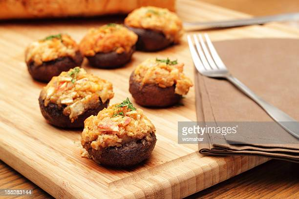 Photograph of stuffed mushrooms on a cutting board