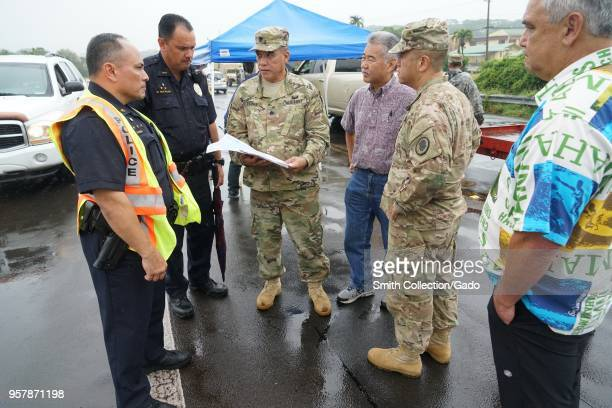 Photograph of Task Force Hawaii Commander Shawn Tsuha and Brigadier General Kenneth Hara with police officers and Hawaiian governor David Ige during...