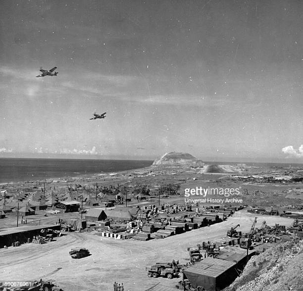 Photograph of the 21st Bomber Command P-51s Flyover in Iwo Jima Bonin Islands, Japan. Dated 1945.