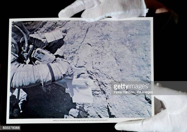A photograph of the cuff mounted checklist worn by astronaut Charles Duke during the Apollo 16 mission on the surface of the moon estimated at...