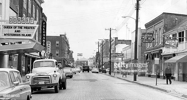 Photograph of the downtown area in Cambridge Maryland prior to protests to end racial segregation showing movie theatres a men's wear store a tavern...