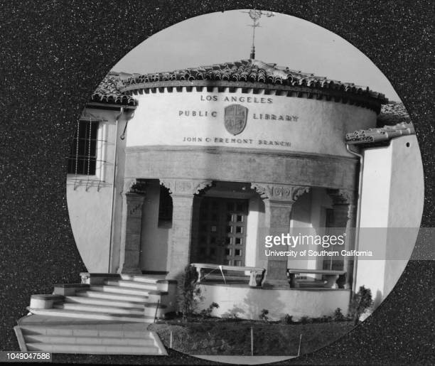 Photograph of the front entrance to the John C Fremont Branch of the Los Angeles Public Library 6121 Melrose Avenue Examiner clipping attached to...