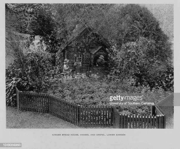 Photograph of the Ginger Bread House and Hansel and Gretel in the Lower Garden of Busch GardensStreetscape Horizontal photography600 Busch Garden...